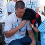 Photo of Transition House volunteer with dog.