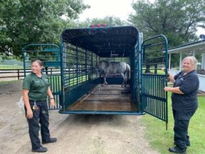 Leslie, left and Charlene deliver Sir Phillip to Mill Creek Farm in Alachua, Florida