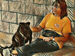 Drawing of volunteer sitting with a large black dog